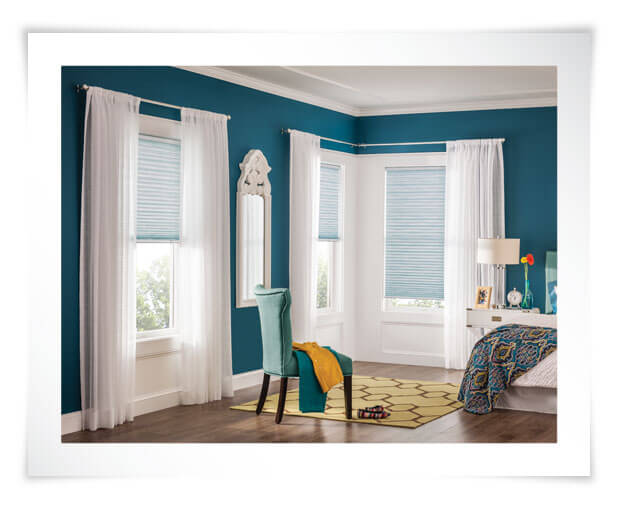Sheer drapery adds a soft window treatment look