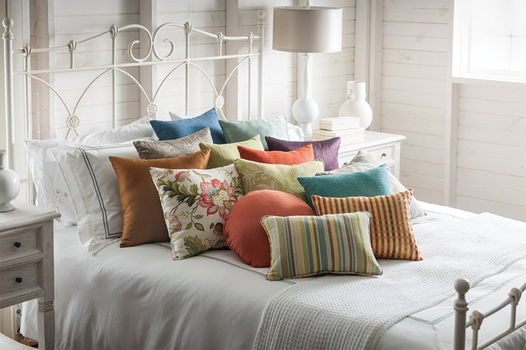 Bali Custom Coordinating Pillows arranged on a bed