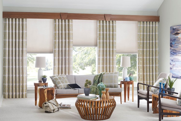 Living room with Bali 3⁄8 inch Double Cell Cellular Shades, Drapery, and Noble Wood Cornices