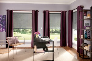 Pretty purple Bali Custom Drapery with Solar Shades and AutoView Motorized Lift in a contemporary office